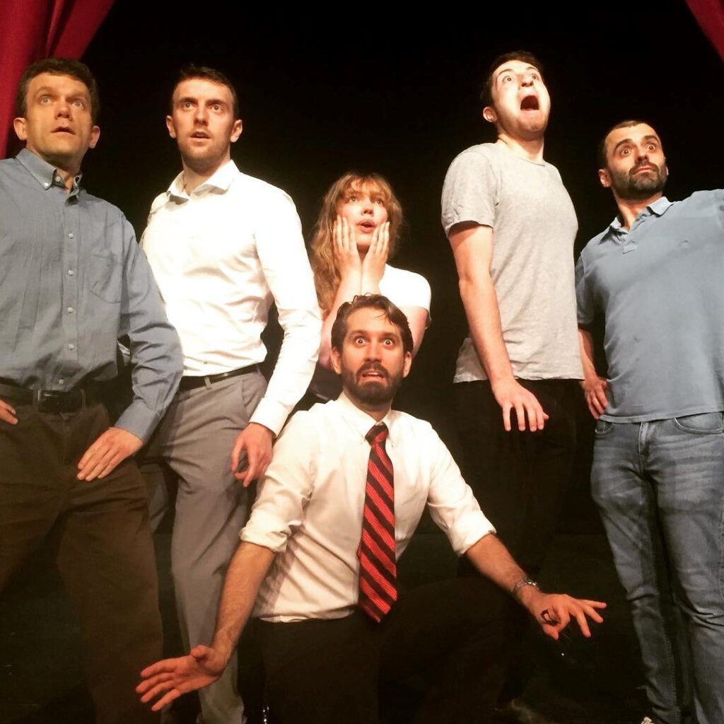 Improvisers looking horrified at an imagined B-Movie monster